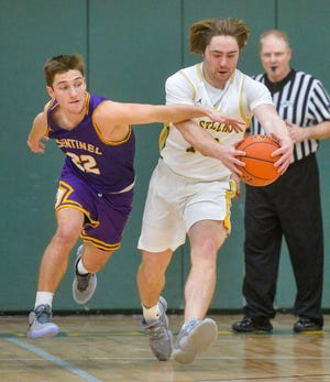 CMR's Griffin Held gets to a loose ball ahead of Sentinel's Soren Syvrud on Thursday in the CMR Fieldhouse.