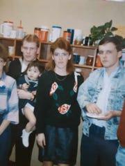 Second in a family of five children, Cheryl Larsen, center, is shown here with her brothers Richerd Peplinski, left, holding daughter, Megan LeDeau and Stanley Peplinski.