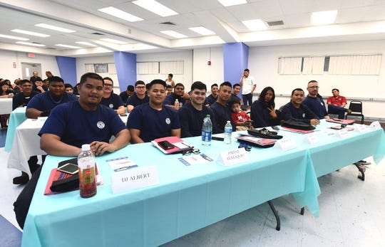 Twenty-one participants of the Guam Community College Ship Repair Transportation Boot Camp ll program during their completion ceremony at GCC in Mangilao, Dec. 20, 2019.