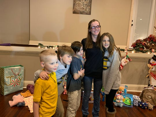 Sherry Rodgers enjoys a moment with her children, from left, Kenneth Hartfield, 7, Michael Rodgers, 9, Heath Schultz, 10, and Abigail Schultz, 11, at Lighthouse Rescue Mission in Hattiesburg on Thursday, Dec. 19, 2019.