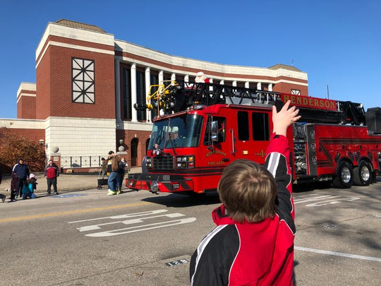 Santa Claus makes his annual tour through Downtown Henderson at the Christmas Parade on Dec. 7, this time atop the Henderson Fire Department's Ladder 1 truck.