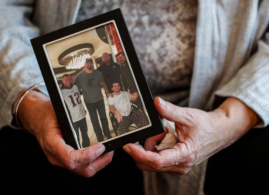 Julie Lewis holds a photo of her son, Jacob Lewis, whose organ donations helped several others.