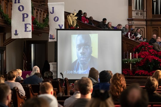 A photo of Billy Joe Hunter and others who died while experiencing homelessness in Indianapolis this year, appears on the screen during the annual Coalition for Homelessness Intervention and Prevention memorial service at Roberts Park United Methodist Church, Friday, Dec. 20, 2019.