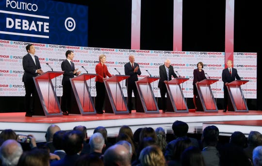 Democratic presidential candidates Andrew Yang (from left), Pete Buttigieg, Elizabeth Warren, Joe Biden, Bernie Sanders, Amy Klobuchar and Tom Steyer participate in a Democratic presidential primary debate Thursday, Dec. 19, 2019, in Los Angeles.