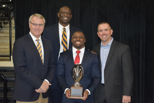 Charles Salary (center front) is flanked by (left to right) Marian president Daniel Elsener, athletic director Steve Downing and coach Mark Henninger.