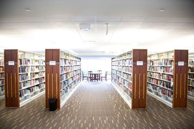 Shelves of books on the main floor are pictured, Wednesday, Oct. 16, 2019, at the Public Library in Coralville, Iowa. Iowa.