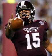 Dak Prescott celebrates one of many touchdowns he scored for Mississippi State.