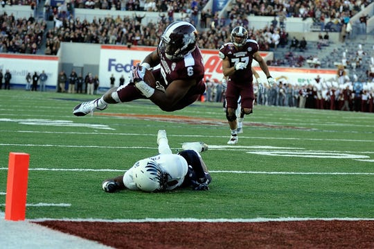 MEMPHIS, TN - DECEMBER 31:  Malcolm Johnson #6 of the Mississippi State Bulldogs dives for a touchdown over Jaylon Finner #25 of the Rice Owls during the 55th annual AutoZone Liberty Bowl at Liberty Bowl Memorial Stadium on December 31, 2013 in Memphis, Tennessee.
