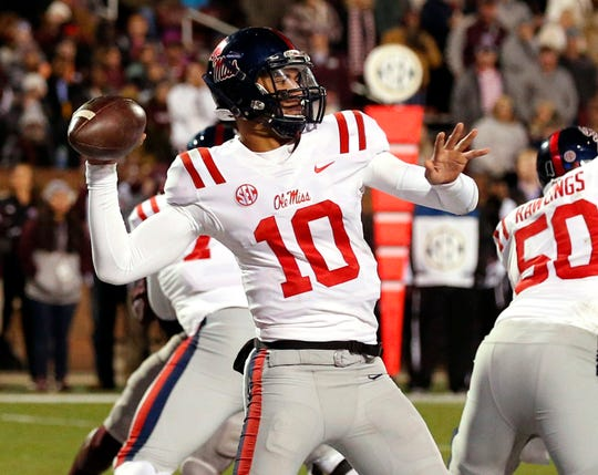 Ole Miss quarterback Jordan Ta'amu (10) sets up to throw a pass against Mississippi State during the second half of an NCAA college football game in Starkville, Miss., Thursday, Nov. 23, 2017.