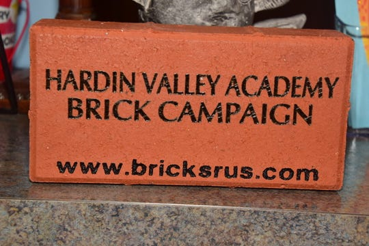 The Hardin Valley Academy Foundation raises money selling personalized bricks at a phonathon held at the school Thursday, Dec. 12. The front entrance to the school will be revitalized in sections using the bricks.