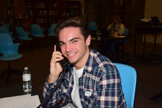Alum Nick Filipkowski said he wanted to help out his alma mater by selling personalized bricks at a phonathon sponsored by the Hardin Valley Academy Foundation held at the school Thursday, Dec. 12.