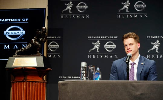 NCAA college football player and Heisman Trophy finalist, LSU quarterback Joe Burrow listens to questions from the media during a news conference before the Heisman Trophy ceremony, Saturday, Dec. 14, 2019, in New York. (AP Photo/Jason Szenes)