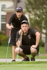 Pinckney's Jordan Andrus (back) and Otto Black were all-state golfers in the early part of the decade.