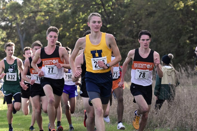 Brighton's Jack Spamer (77) and Zach Stewart (78) and Hartland's Riley Hough (center) were three of the top boys cross country runners in Livingston County in the past decade.