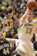 Howell's Tyler Johnson scores in a state quarterfinal basketball loss to Mount Pleasant in 2014.