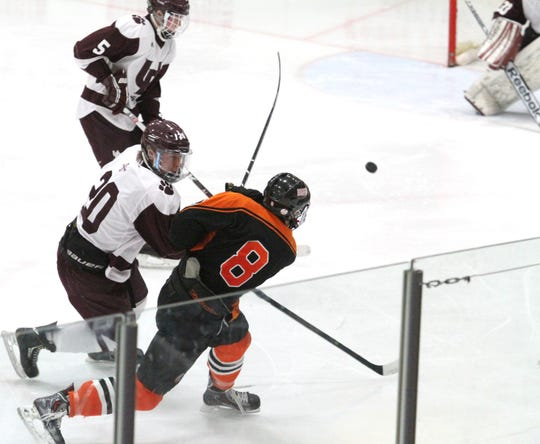 Brighton's Brett Pietila fires the game-winning goal in a 4-3 overtime victory over Detroit U-D Jesuit on March 7, 2014.