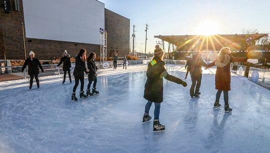 Skaters enjoy the ice rink at Paristown Hall.December 19, 2019