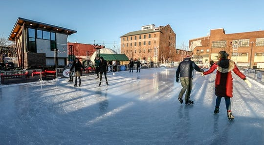 Skaters enjoy the ice rink at Paristown Hall.