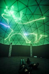 Patrons at Paristown Hall enjoy a laser light show on a 36-foot geometric dome. It's a 20-minute show that comprises about 40 holiday songs synchronized perfectly to lasers.