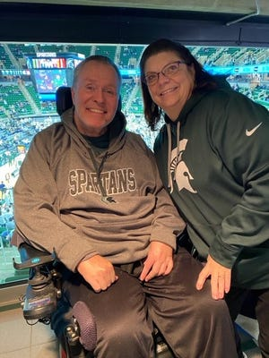 Keith and Sarah Stone, of Portage, at a Dec. 8 MSU men's basketball game.