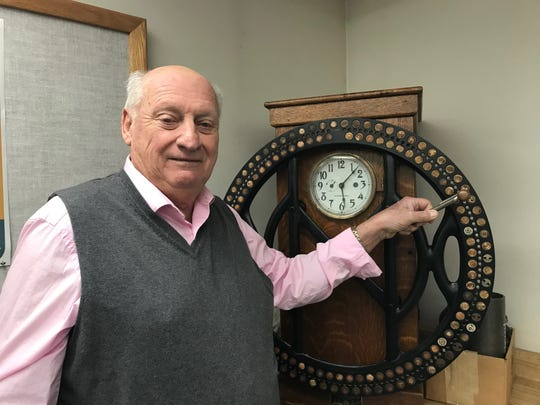 """Bill """"Robbie"""" Robertson, 76, used a time clock just like this one from 1962 until 1991 first as Copperweld and now Arcelormittal. Robertson took a voluntary layoff and will retire in January after 57 years."""