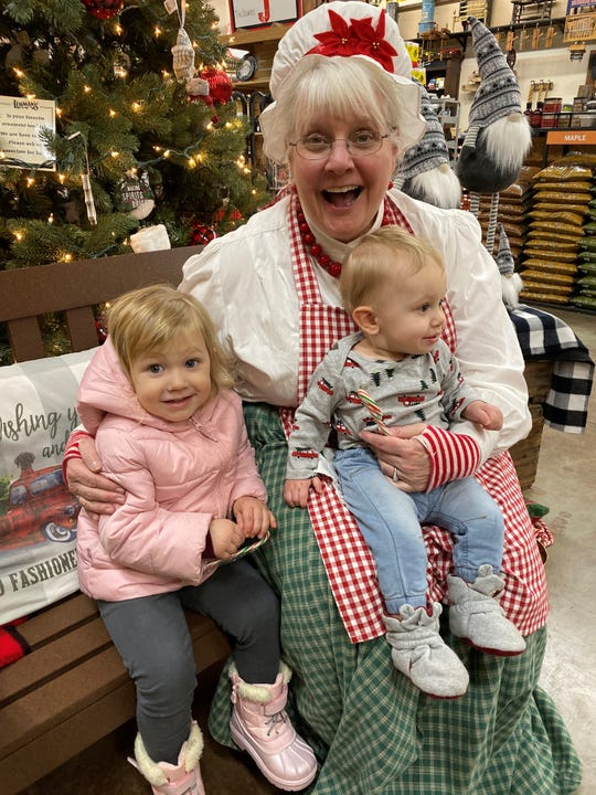 For some children, especially younger ones, meeting Santa can be a bit daunting with his scruffy beard and booming voice. Mrs. Claus provides a softer approach for Christmas photos. Jacki Chamberlain (Mrs. Claus) with Cecilia and Vincent Agosta.