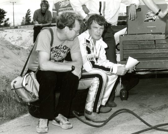 The Rev. Dale Grubba talks with stock-car driver Dick Trickle before a race at Wisconsin International Raceway in Kaukauna in the 1980s. Grubba became a racing fan in his youth, covered the sport for various publications and has been a friend and adviser to numerous drivers.