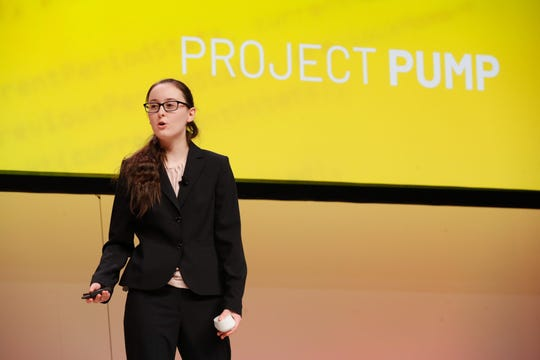 Louisa Wood, a junior at Nicolet High School, presents her idea at Rockwell Automation's You Make It Challenge. Wood's idea involves a software application to measure water levels in sump pumps.