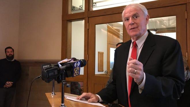 Mayor Tom Barrett speaks to reporters at City Hall.