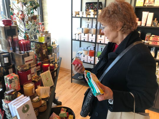Mary Banerian of New York visits Mooi for the first time. The new store, at 7600 Harwood Ave., Wauwatosa, offers customers a variety of soaps, candles, cards, incense, scarves and more.