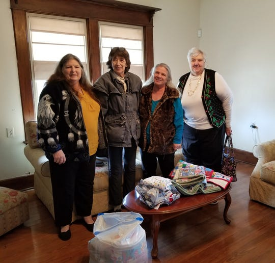 Members of the Creative Crafters group recently made blankets and exam gowns for the Grandma's House Children's Advocacy Center in Mountain Home. The group also collected stuffed animals to be used at the house. Creative Crafters members (left to right) Sandi Kiputh, Myrna Bingham, Linda Reed and Carol Burdick are depicted standing next to the donated blankets and exam gowns.