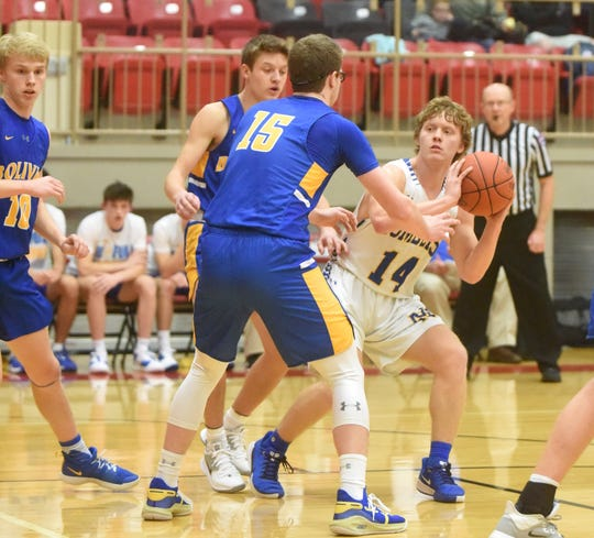 Mountain Home's Abe Crawford looks to pass during a recent contest.
