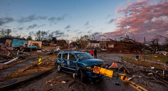 The sun sets after a tornado touchdown in Wetumpka, Ala., on Saturday afternoon January 19, 2019.