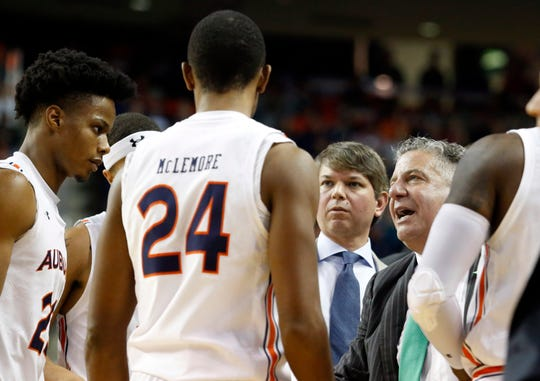 Auburn head coach Bruce Pearl (right) huddles with players during a game against NC State at Auburn Arena on Dec. 19, 2019.