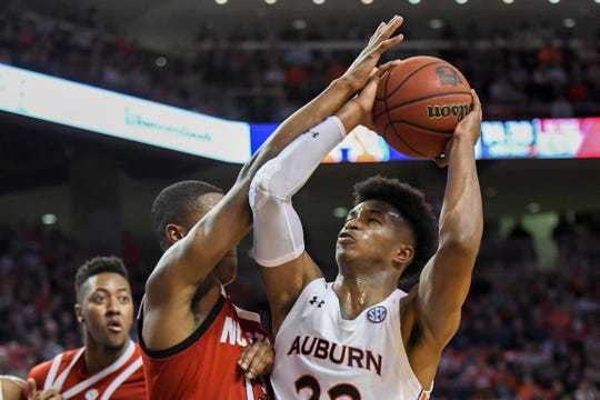 North Carolina State guard C.J. Bryce (13) fouls Auburn guard Allen Flanigan (22) during the second half of an NCAA college basketball game Thursday, Dec. 19, 2019, in Auburn, Ala. (AP Photo/Julie Bennett)