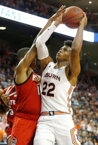 Dec 19, 2019; Auburn, AL, USA; North Carolina State Wolfpack guard C.J. Bryce (13) fouls Auburn Tigers guard Allen Flanigan (22) during the second half at Auburn Arena. Mandatory Credit: John Reed-USA TODAY Sports