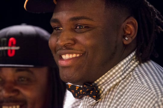 Tennessee signee James Robinson poses for pictures during a signing ceremony at Carver High School in Montgomery, Ala., on Friday, Dec. 20, 2019.