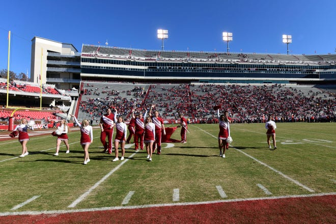 Arkansas cheerleaders try to get the remaining fans at Razorback Stadium excited before the start of the fourth quarter against Western Kentucky on Saturday, Nov. 9, 2019 in Fayetteville, Ark.