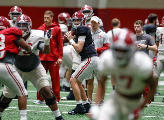 Alabama sophomore  quarterback Mac Jones looks to pass during a recent bowl practice inside the Alabama indoor practice facility on Tuesday, Nov. 17, 2019 in Tuscaloosa. (Photo by Kent Gidley/Alabama athletics)