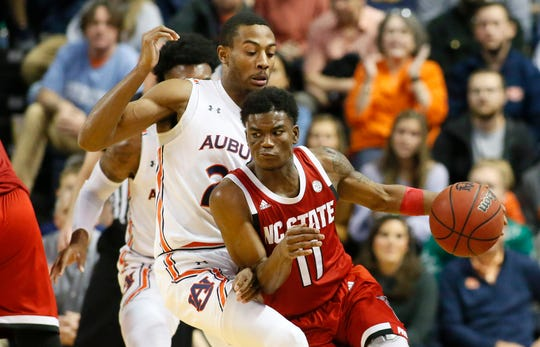 North Carolina State Wolfpack guard Markell Johnson (11) dribbles the ball as Auburn Tigers forward Anfernee McLemore (24) defends during the second half at Auburn Arena.