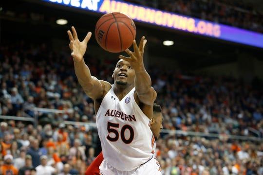 Auburn center Austin Wiley (50) tries to grab a rebound against NC State on Dec. 19, 2019.