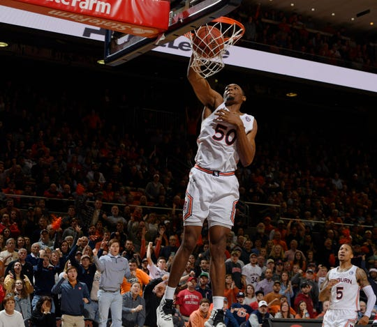 Auburn's Austin Wiley gets a dunk in the second half against NC State on Thursday, Dec. 19, 2019 in Auburn, Ala.