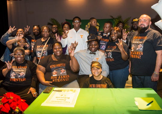 Tennessee signee James Robinson poses for a picture with his family during a signing ceremony at Carver High School in Montgomery, Ala., on Saturday, Dec. 31, 2011.