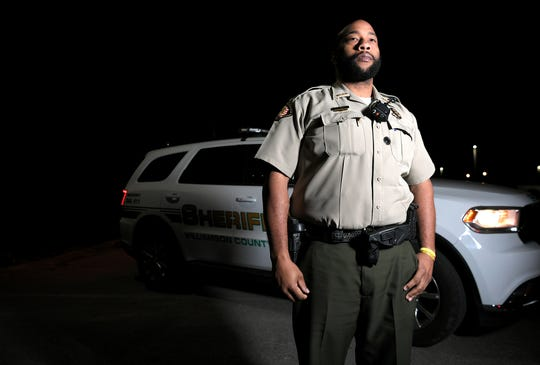 Williamson County Sheriff's Deputy Adrian Finch coaxed a man from committing suicide off the Natchez Trace Parkway Bridge on a  Nov, night. Finch works the night shift and stands next to his patrol vehicle at the Williamson County Sheriff's headquarters in Franklin on Thursday, Dec. 19, 2019.