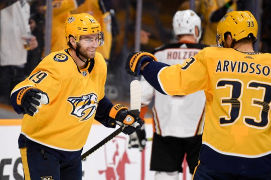 Calle Jarnkrok, center — Nashville Predators center Calle Jarnkrok (19) reacts to scoring a goal against the Anaheim Ducks with right wing Viktor Arvidsson (33) during the third period at Bridgestone Arena in Nashville, Tenn., Tuesday, Oct. 22, 2019.