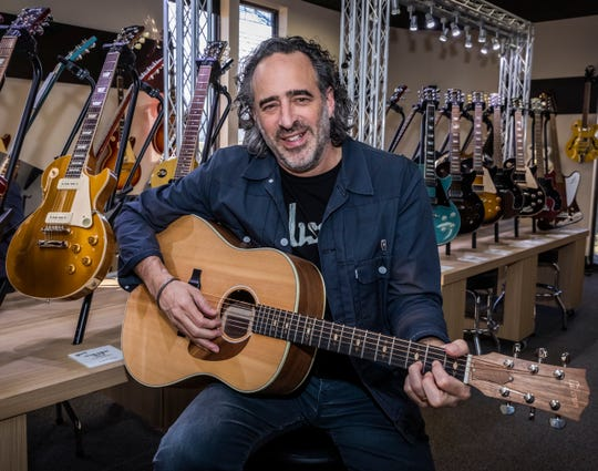 Gibson CEO JC Curleigh poses with a guitar at the Gibson factory showroom in Nashville, Tenn. on Thursday Dec. 19, 2019.