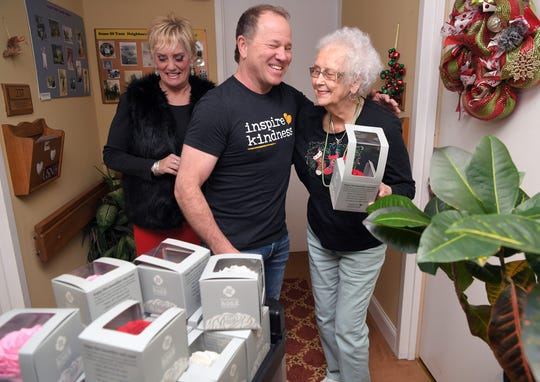 Inspire Kindness President and Co-founder Dan Green, middle, gives a kindness rose to Maybelle Carter Living resident Ann McClain on Thursday, Dec. 20, 2019. Green sold his company to a Nashville-based Southwestern Family of Companies and moved to Nashville from the Chicago area.  Green and his team gave roses to all the residents with the help of Maybelle Carter Living sales director Julie Ruffner, left, on Thursday, Dec. 20, 2019.