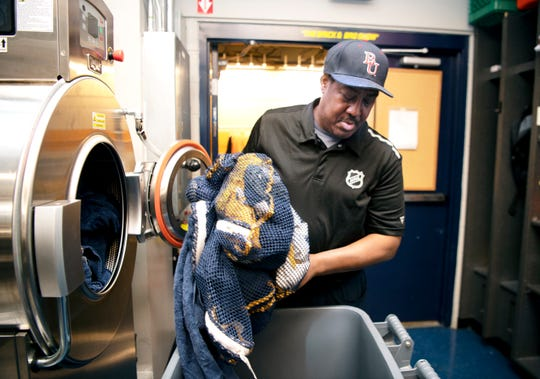 Craig Baugh cleans the team's laundry after a Predators' practice at Bridgestone Arena on Tuesday, Dec. 10, 2019. Baugh has been with the Predators as a clubhouse assistant since they began the franchise.