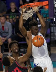 Mark Williams of IMG Academy dunks during their matchup against Archbishop Stepinac in the 2019 City of Palms Classic on Friday, Dec. 20, 2019, at Suncoast Credit Union Arena in Fort Myers.