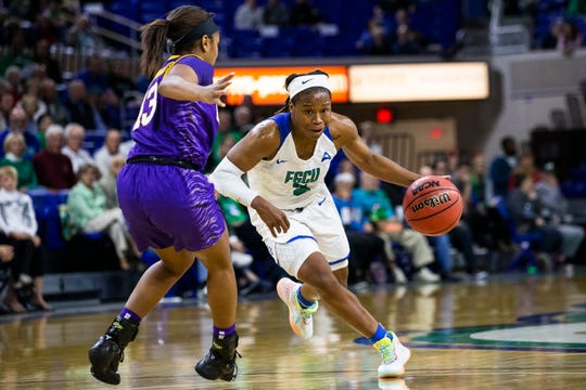 Keri Jewett-Giles of the Florida Gulf Coast University runs with the ball during a game against Louisiana State University on Thursday, December 19, 2019, at Alico Arena in Estero.